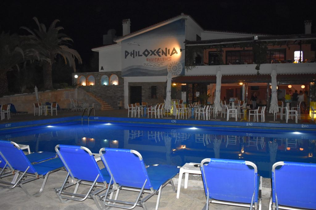 Dining room, bar, and pool area at Philoxenia Bungalows