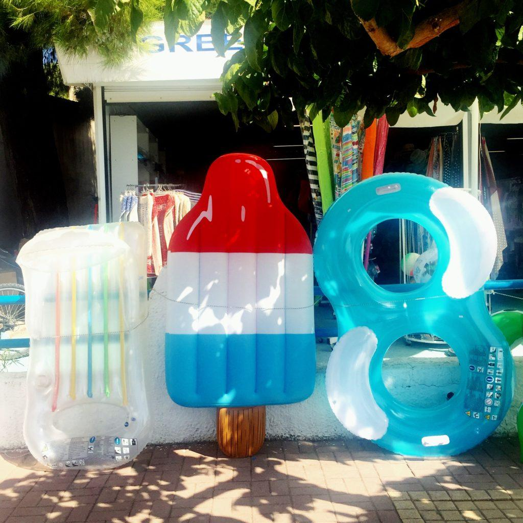 Inflatable flotation devices at a shop in Psakoudia